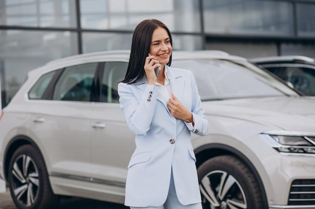 Female salesperson in a car showroom