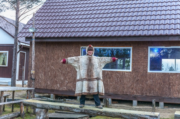 Female sami, sami in national dress, sami village on the kola peninsula, russia.