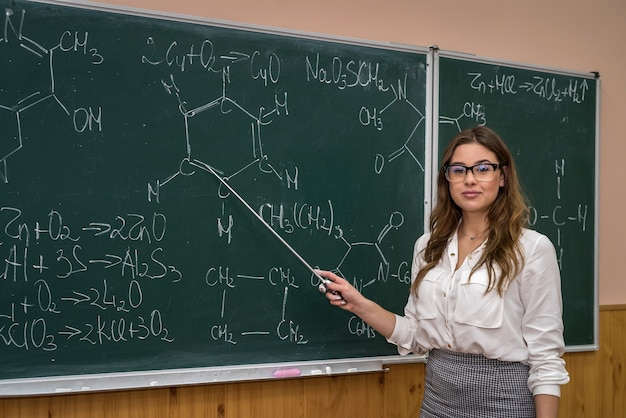 Female science student with glasses explain chemistry lesson at school. education