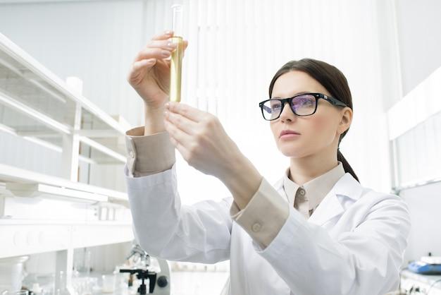 Female scientist holding test tube