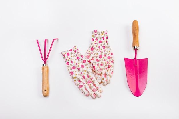 Female set tools working garden pink flowers