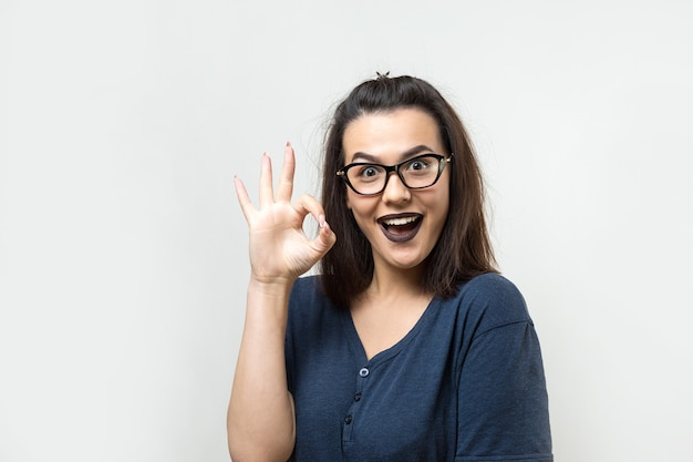 Female shows okay sign, demonstrates that everything is fine, agrees.