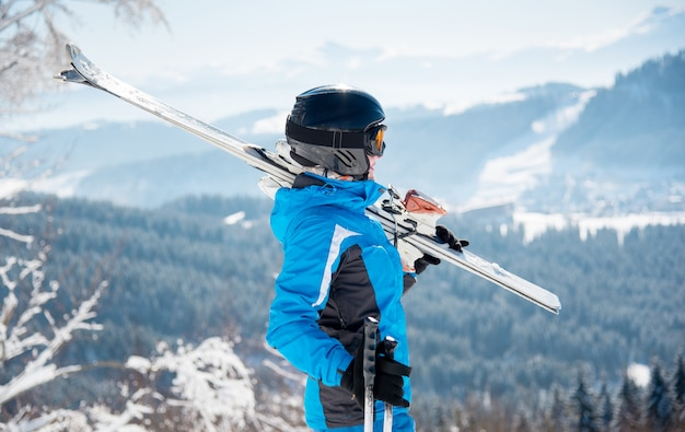 Female skier with her skis