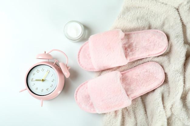 Female sleep routine accessories on white background