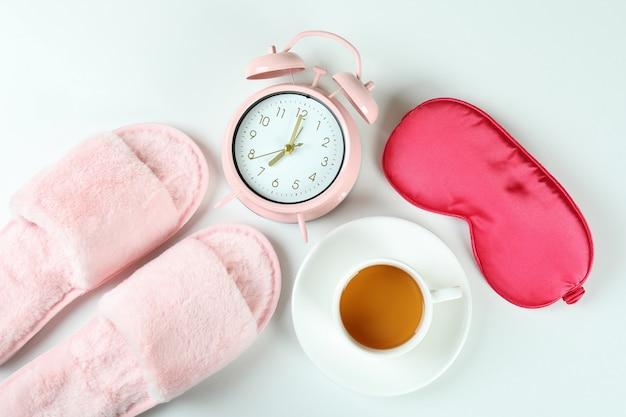 Female sleep routine accessories on white