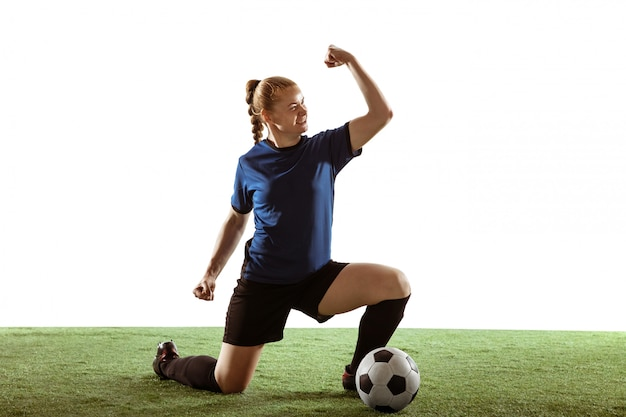 Female soccer, football player kicking ball, training in action and motion isolated on white background