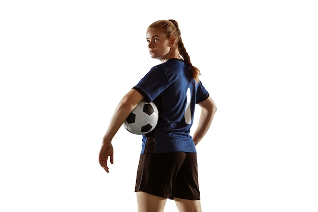 Female soccer, football player posing confident with ball isolated on white