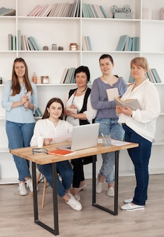 Female social club using a laptop
