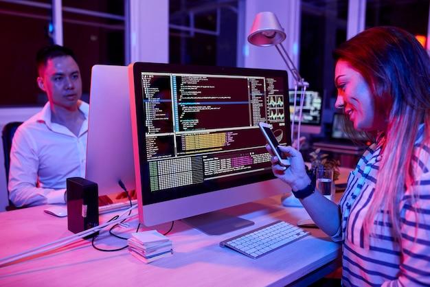 Female software developer texting