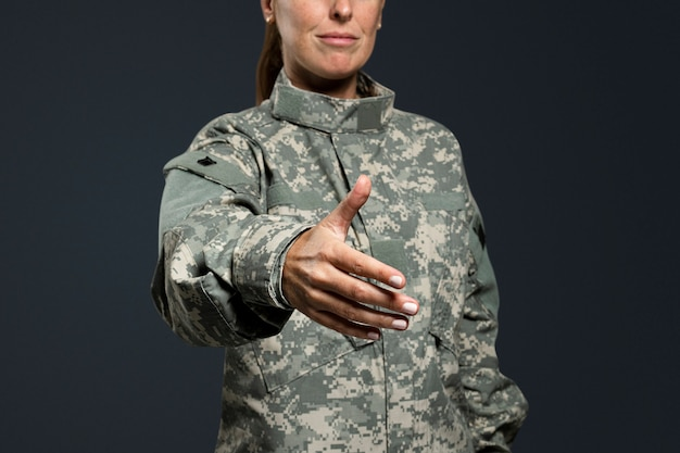 Female soldier extended out her hand
