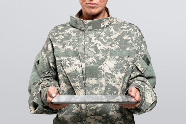 Female soldier holding a tablet army technology