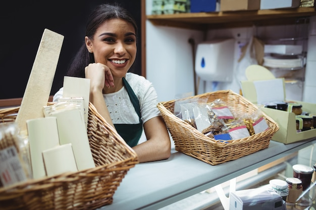 Female staff smiling at food counter