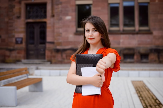 Female student expressing annoyance and dislike of studying at university