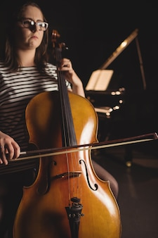 Female student playing double bass