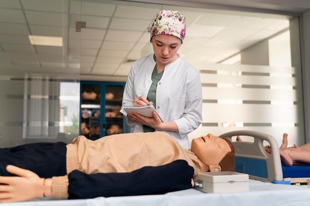 Female student practicing medicine
