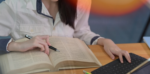 Female student studying at college library