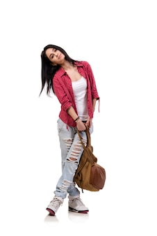 Female student with backpack isolated on white
