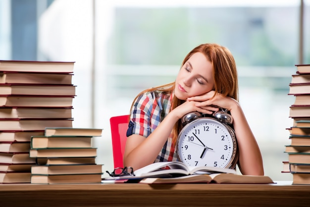 Female student with clock preparing for exams