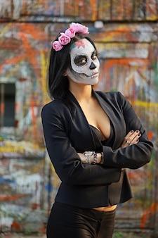 Female sugar skull makeup. face painting art.