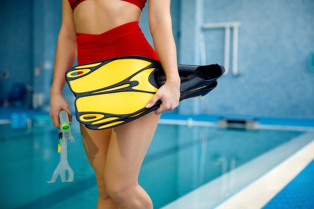 Female swimmer with mask and snorkel for scuba diving at the poolside