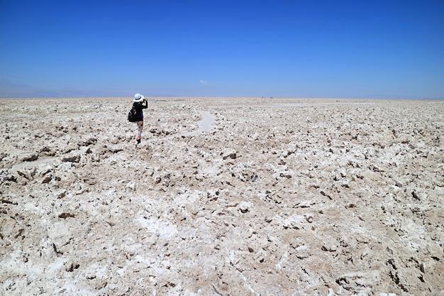 Female taking photos of salar de atacama landscape