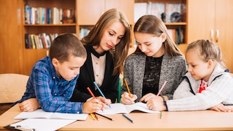 Female teacher and pupil in studying process