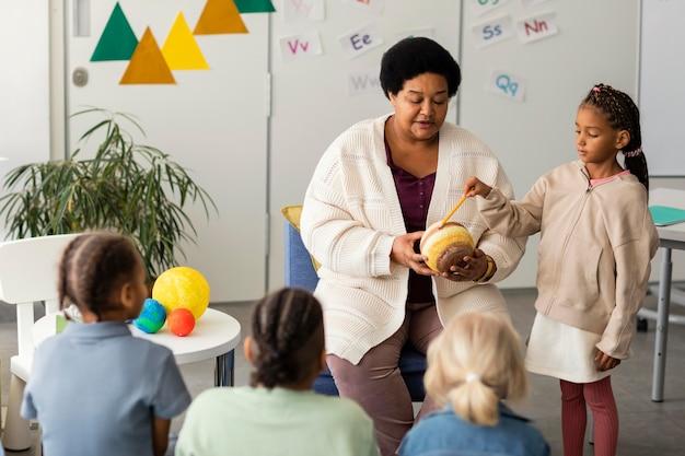 Female teacher explaining to her pupils
