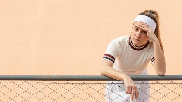 Female tennis player having a break