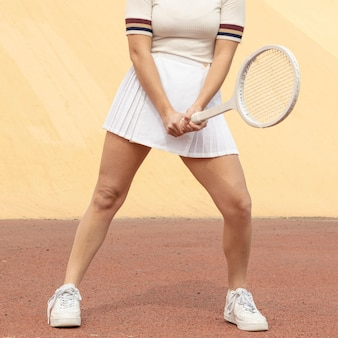 Female tennis player holding racket