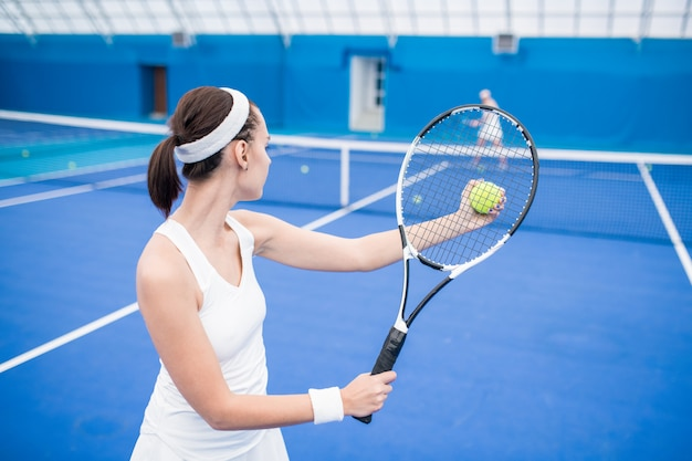 Female tennis player in match