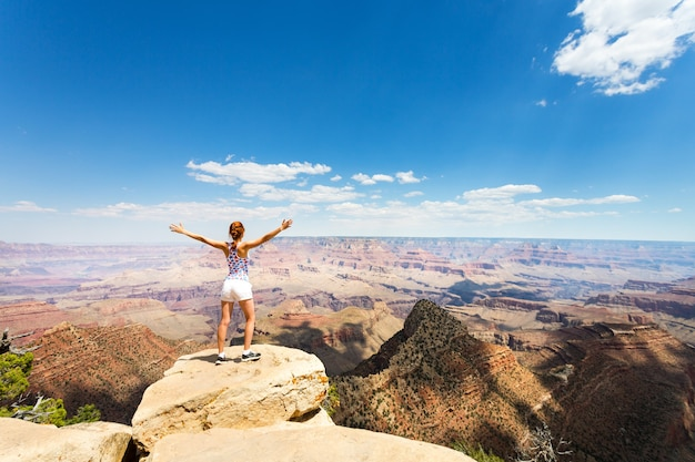 Female tourist look at grand canyon landscape