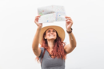Female tourist looking at map