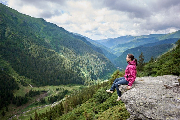 Female tourist on rock edge