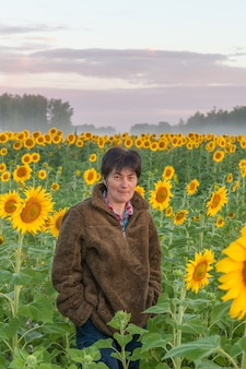 Female tourist in the sunflower field