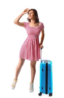 白い背景の上の荷物を持つ女性の観光客