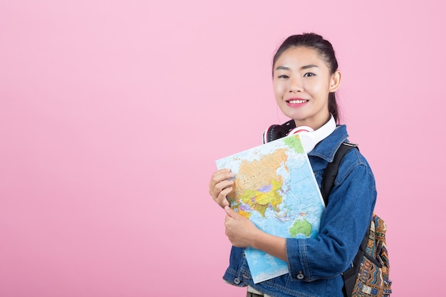 Female tourists in the studio on a pink background.