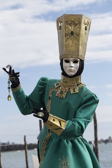 Female in a traditional venice mask during the world-famous carnival