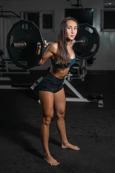 Female training with barbell