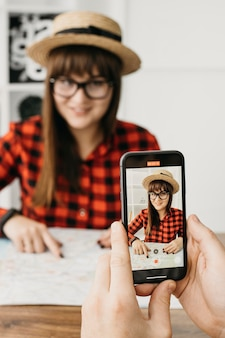Female travel blogger streaming with mobile phone