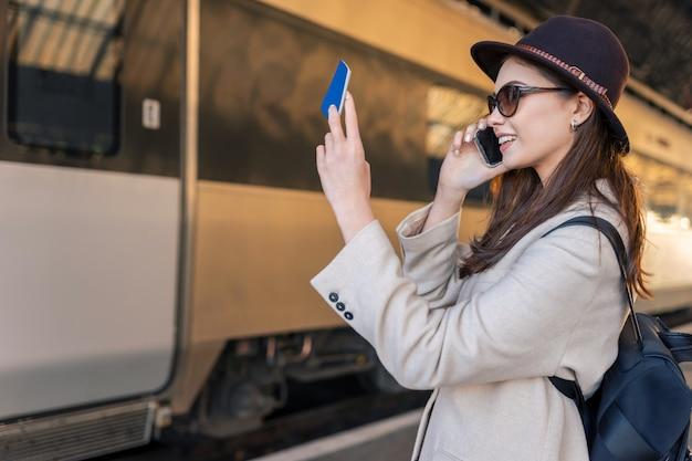 Female traveler looks in passport