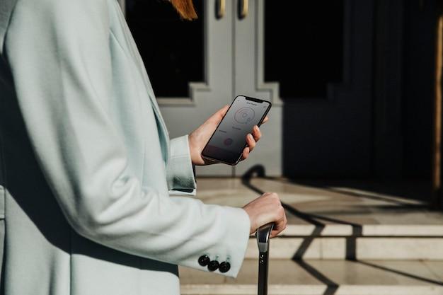Female traveler using her phone on a street