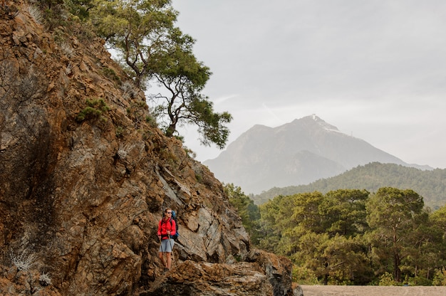 Female trekker climbs on hills in turkey