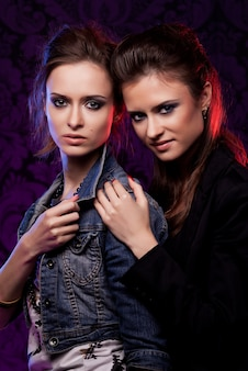 Female twins in colored light
