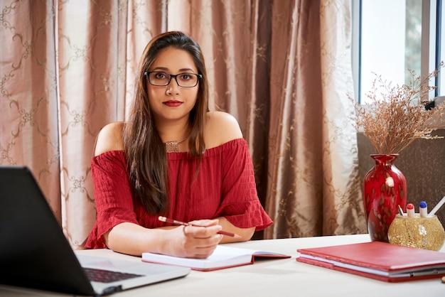 Female university student doing homework