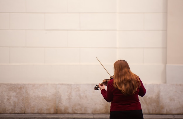 Female violinist playing in the street