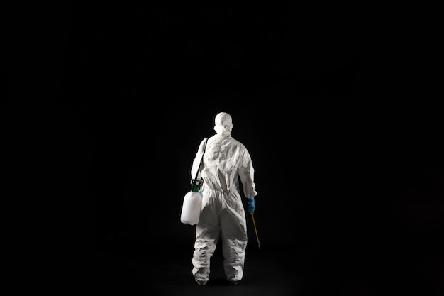 Female virologist, she wears ppe.he stands back.