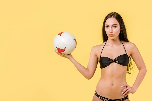 Female volleyball player in bikini