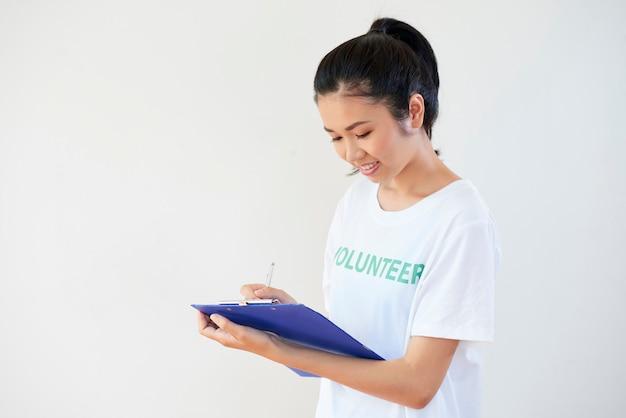 Female volunteer filling the form