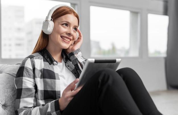 Female wearing headphones medium shot