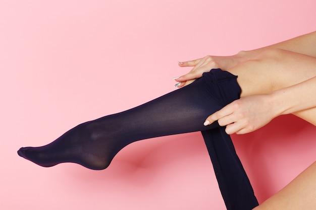 Female wears dark blue tights